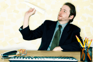 man procrastinating at computer