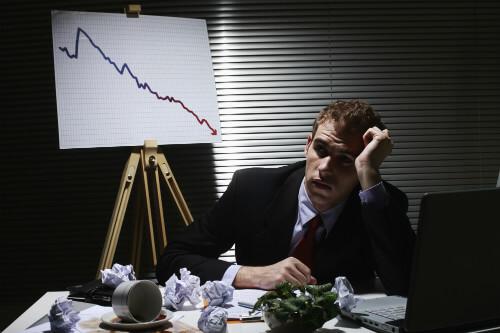 failed businessman at desk